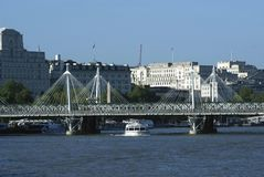 The Hungerford Bridge over River Thames in London, England, Europe Stock Photography
