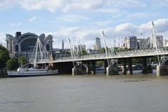 The Hungerford Bridge over River Thames in London, England, Europe Stock Photo