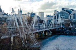 The Hungerford and Golden Jubillee bridges on the River Thames Stock Images