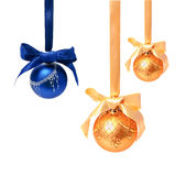 Hunging golden ahd blue christmas balls isolated Royalty Free Stock Images