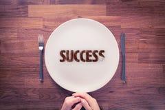 Hungrigt för framgång arkivfoto