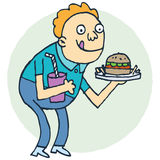Hungry. Young person about to eat a burger and chips Royalty Free Stock Photos