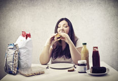 Hungry. Young woman eating hot dog Royalty Free Stock Image