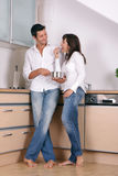 Hungry. Eating tasting cooking couple in the kitchen royalty free stock photo