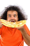 Hungry !!. Hungry man eating a tasty pizza Royalty Free Stock Images