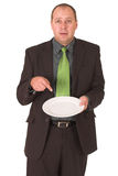 Hungry. Businessman wondering how to put food on the table Stock Photo