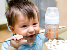Hungry baby boy Stock Photos