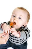 Hungry Baby Boy. Cute baby boy eating a healthy lunch Royalty Free Stock Images