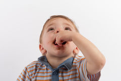 Hungry baby boy eating chocolate Royalty Free Stock Photography