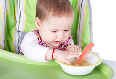 Hungry baby girl Stock Photos
