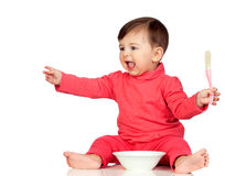 Hungry baby girl yelling for food. On white background Stock Photo