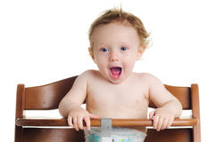 Hungry baby high chair Stock Photos