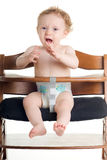Hungry baby high chair Stock Photo