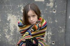 Beggar girl asking for a little money royalty free stock photo