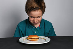 Hungry boy Royalty Free Stock Photos