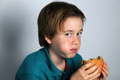 Hungry boy Royalty Free Stock Image