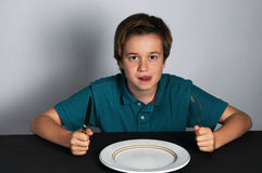 Hungry boy. Hungry teenager waiting for food royalty free stock images