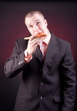 Hungry businessman Royalty Free Stock Photos
