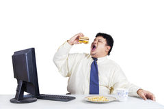 Hungry businessman eating fast food Royalty Free Stock Photo