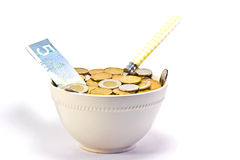 Hungry for Cash. ?? A cereal bowl filled with money Royalty Free Stock Image