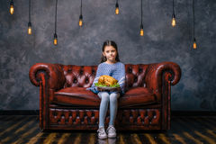 Hungry child with tasty fried chicken in the hand Royalty Free Stock Photo