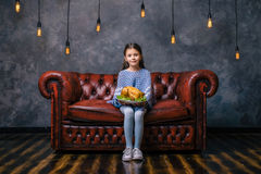 Hungry child with tasty fried chicken in the hand Royalty Free Stock Photography