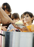 Hungry children in refugee camp Royalty Free Stock Photos
