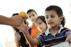 Hungry children in refugee camp Royalty Free Stock Images