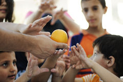Hungry children in refugee camp, Stock Photo