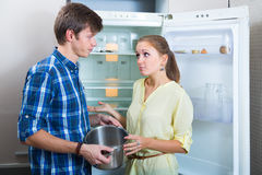 Hungry couple near empty fridge Royalty Free Stock Images