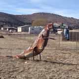 The Hungry Dinosaur Sculpture. Sheet metal, welder, dinosaur, sculpture, trailer Royalty Free Stock Image