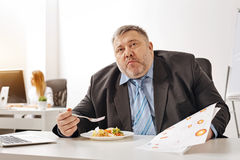 Hungry distressed worker looking overwhelmed Royalty Free Stock Image