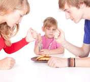 Hungry family Stock Images