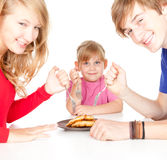Hungry family Royalty Free Stock Photo