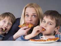 Hungry family, mother and son eating pizza Royalty Free Stock Images