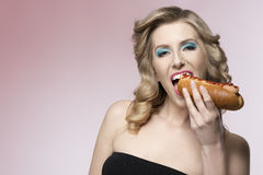 Hungry  fashion girl Royalty Free Stock Photos