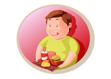 Hungry fat child  with junk food Royalty Free Stock Photography