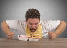 Hungry fat man Stock Image