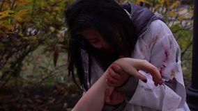 Hungry female vampire eating victim's dead body, monsters invasion, cannibalism. Stock footage stock video footage