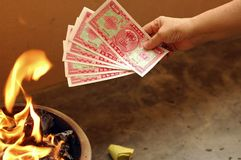 Hungry Ghost Chinese Festival. A typical burning fake money and gold for ancestors during Chinese Hungry Ghost Festival Stock Image