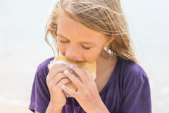 Hungry girl with an appetite for eating pie. A hungry girl with an appetite for eating pie Stock Image