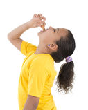 Hungry Girl Eating Biscuit Stock Image