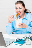 Hungry girl eating noodles Royalty Free Stock Images