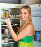 Hungry  girl eating  soup from pan Royalty Free Stock Image