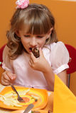 Hungry Girl In Cafe Royalty Free Stock Images