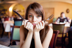 Hungry girl in a restaurant Stock Photo