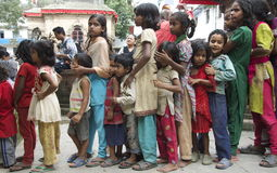 Hungry Homeless Kids. Homeless Nepalese kids play while standing in line for a free meal Stock Image