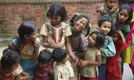 Hungry Homeless Kids. Homeless Nepalese kids play while standing in line for a free meal Royalty Free Stock Image