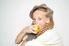 Hungry and homelss. old fashioned child in beret. retro fashion model. Vintage. teen girl in retro male suit. street kid royalty free stock images