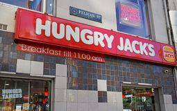 Hungry Jack`s fast food restaurant exterior of the store located Oxford St & Cnr Pelican Street. royalty free stock photography